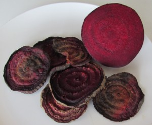 browned slices of beets, ready to be chopped and steeped in simmering water